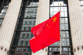 Chinese flag floating in front of a goverment building - PhotoDune Item for Sale