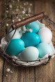 Dyed Easter eggs in a wire basket - PhotoDune Item for Sale