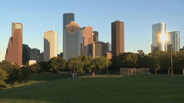 VideoHive Joggers Run Beneath The Houston Skyline 10896128