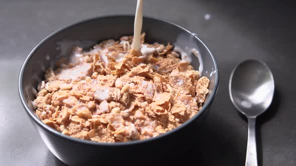 Pouring Cereal Flakes And Milk 4 Of 8