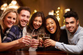 Group Of Friends Enjoying Evening Drinks In Bar - PhotoDune Item for Sale