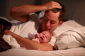 Father Lying In Bed With Crying Baby Daughter - PhotoDune Item for Sale