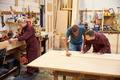 Staff Working In Busy Carpentry Workshop - PhotoDune Item for Sale