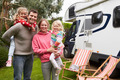 Portrait Of Family Enjoying Camping Holiday In Camper Van - PhotoDune Item for Sale