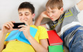Brothers with a Books and Cellphone - PhotoDune Item for Sale