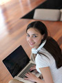 relaxed young woman at home working on laptop computer - PhotoDune Item for Sale