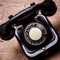 Old black phone with dust and scratches on wooden floor - PhotoDune Item for Sale
