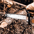 Man sawing a log in his back yard - PhotoDune Item for Sale
