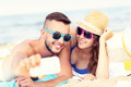 Young couple taking selfie at the beach - PhotoDune Item for Sale