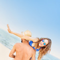 Crazy couple having fun at the beach - PhotoDune Item for Sale