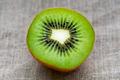 Macro kiwi fruit close up on hessian linen fabric cloth background - PhotoDune Item for Sale