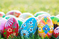 Hand-painted Easter eggs on grass. Spring patterns art, unique. - PhotoDune Item for Sale