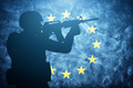 Soldier on grunge European Union flag. Army, military of Europe - PhotoDune Item for Sale