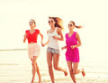 group of smiling women running on beach - PhotoDune Item for Sale