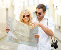 smiling couple in sunglasses with map in the city - PhotoDune Item for Sale