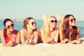 group of smiling women in sunglasses on beach - PhotoDune Item for Sale