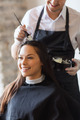 happy woman with stylist coloring hair at salon - PhotoDune Item for Sale