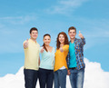 group of smiling teenagers showing thumbs up - PhotoDune Item for Sale