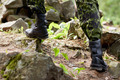 close up of soldier climbing on rocks in forest - PhotoDune Item for Sale