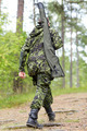 young soldier or hunter with gun in forest - PhotoDune Item for Sale
