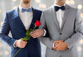 close up of happy male gay couple holding hands - PhotoDune Item for Sale