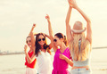 group of smiling women dancing on beach - PhotoDune Item for Sale