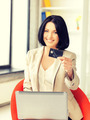 happy woman with laptop computer and credit card - PhotoDune Item for Sale