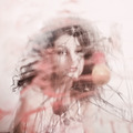 Portrait of a young curly woman through dirty glass - PhotoDune Item for Sale
