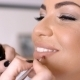 Makeup Artist Applying Lipstick To Pretty Woman - VideoHive Item for Sale