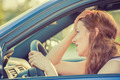 young stressed angry pissed off woman driving car annoyed