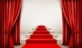 Showroom with red carpet leading to a podium with curtains.  - PhotoDune Item for Sale