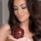 Pretty Woman Looking At Red Apple On Her Hand - VideoHive Item for Sale
