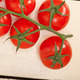 fresh cherry tomatoes on a cluster - PhotoDune Item for Sale