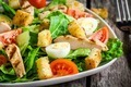Caesar salad with croutons, quail eggs, cherry tomatoes and grilled chicken close up - PhotoDune Item for Sale