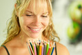 Young female artist holding colored pencils and smiling - PhotoDune Item for Sale