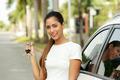 Happy young adult smiling and showing keys of new car - PhotoDune Item for Sale