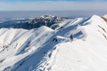 Mountaineer on the ridge in winter conditions - PhotoDune Item for Sale
