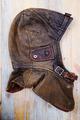 leather vintage helmet over wooden background - PhotoDune Item for Sale