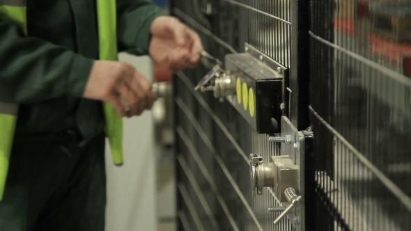 Worker Opening Security Door