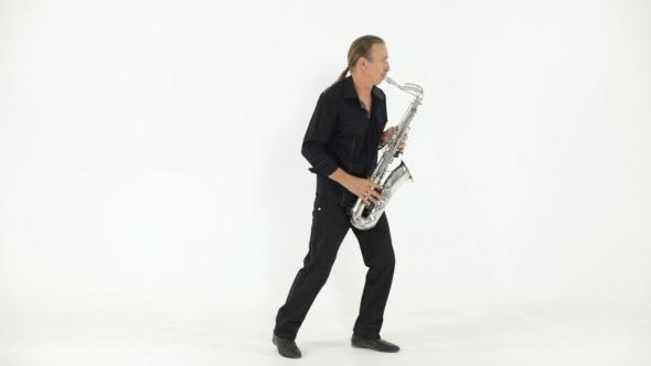 Man In Dark Shirt Playing The Saxophone