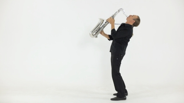 Well Dressed Man Plays The Saxophone