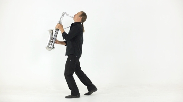 Stylish Saxophonist Plays On Saxophone