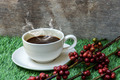 Coffee and raw coffee beans on artificial grass. - PhotoDune Item for Sale