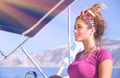 Beautiful woman driving a boat - PhotoDune Item for Sale