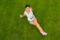 Beautiful girl lying on the grass - PhotoDune Item for Sale