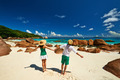 Couple in green having fun on a beach at Seychelles - PhotoDune Item for Sale