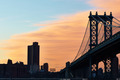 Manhattan Bridge and skyline silhouette view from Brooklyn at sunset - PhotoDune Item for Sale