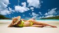 Woman in yellow bikini lying on beach at Seychelles - PhotoDune Item for Sale