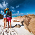 Couple at tropical beach wearing rash guard - PhotoDune Item for Sale