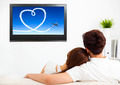 young couple watching the  tv show in living room - PhotoDune Item for Sale